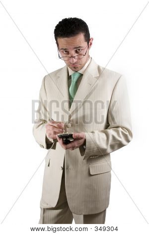 Businessman With Pda Looking Over His Glasses