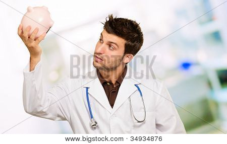 Doctor Holding Piggy Bank, Outdoor