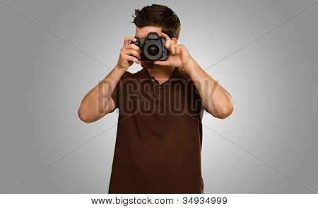 Casual Man Taking Photo Isolated On Grey Background