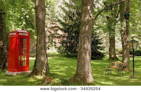 Red telephone booth and bench