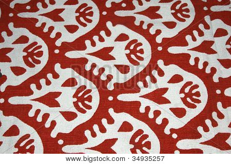 White pattern on red background