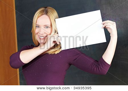 Happy eldery woman holding empty white sign