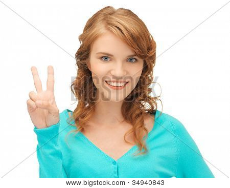 bright picture of teenage girl showing victory sign