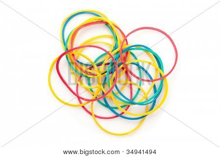 Large group of muti coloured elastics against a white background