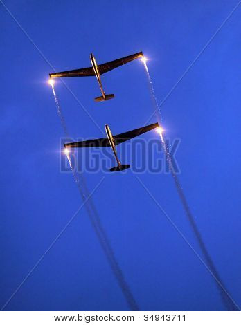ST. WOLFGANG, AUSTRIA - JULY 7: Two Czech gliders L 13 Blanik from The Blanix Glider Team during a famous nightshow in Air Challenge on July 7, 2012 in St. Wolfgang.