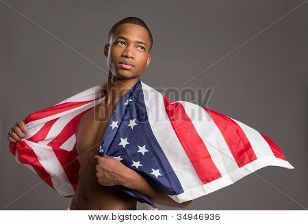 Young African American Athlete Holding American Flag Portrait on Grey Background