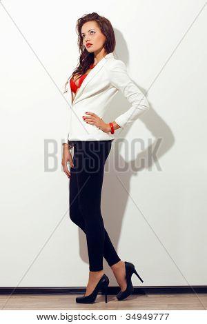 sexy model posing near white wall