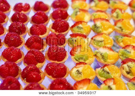 Strawberry And Kiwi Tarts On A Buffett.jpg