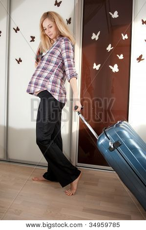 Pregnant Blonde With Suitcase
