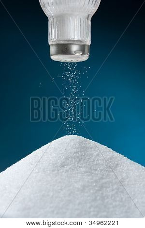 Pouring salt from a salt pot