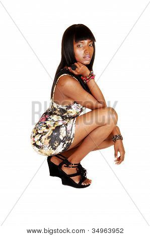 African girl crouching.