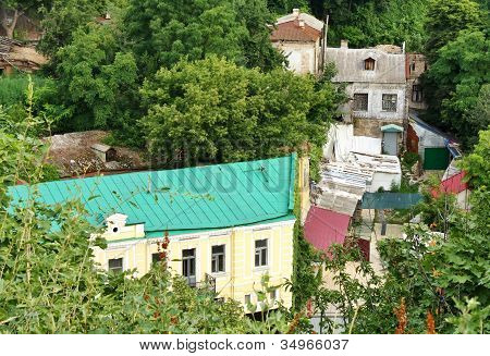 Old Houses Among Green Trees