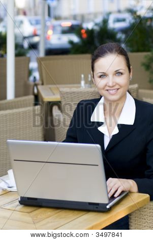 Businesswoman Outdoors With Laptop