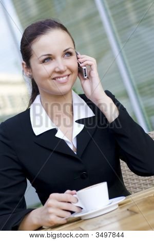 Businesswoman At Outdoor Cafe