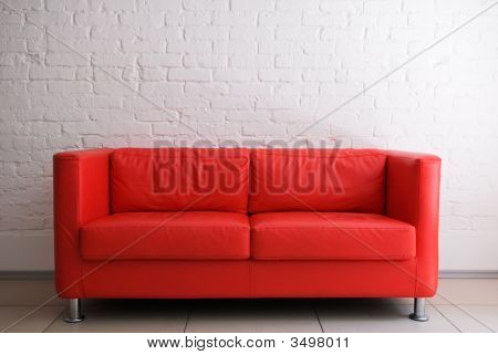 Red Sofa And White Brick Wall