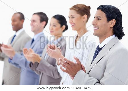 Close-up of  happy business people applauding against white background