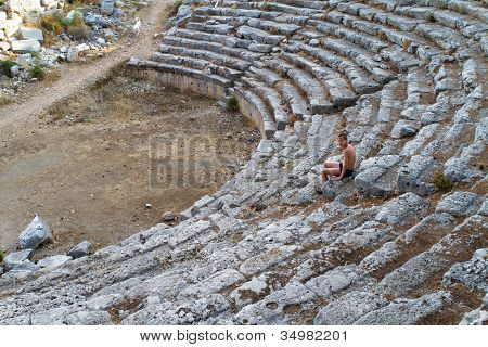 Boy in old greec amphitheater Turkey