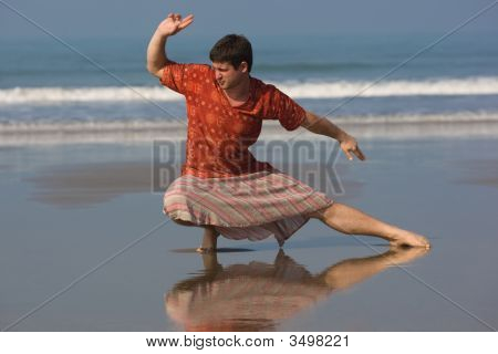 Man Is Doing East Gymnastic On The Beach