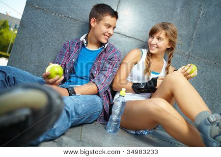 Active young people eating healthy food to stay fit