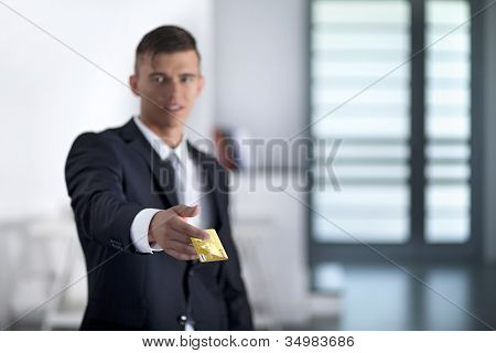 Young Successful Businessman Holding An Credit Card