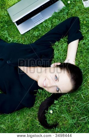Businesswoman Lying Down With Laptop
