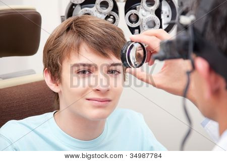 Optometrist taking an eyesight test examination.