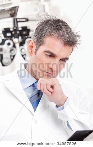 Portrait of doctor in ophthalmology clinic.