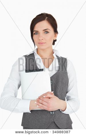 Blue eyed businesswoman holding a digital tablet against white background