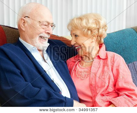 Senior couple in love, flirting on the couch.