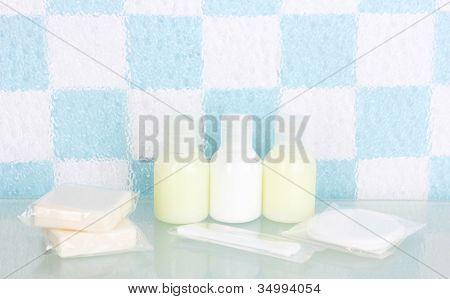 Hotel amenities kit on shelf in bathroom