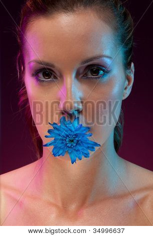 Beautiful Woman With Flower In Mouth