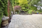 stock photo of fish pond  - Backyard Garden Asian Inspired Paver Patio with Pagoda Pond Bronze and Stone Sculptures - JPG