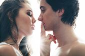 stock photo of shh  - No words being able to express the feelings of two young lovers - JPG