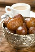 picture of milkmaid  - Indian special sweet Gulab Jamun. Cup of coffee