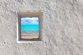Balearic islands idyllic turquoise beach view through whitewashed house open door [ photo-illustrati