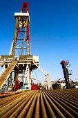 foto of oil drilling rig  - A land drilling rig in Shengli Oil Plant of China - JPG