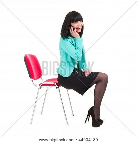 Young business woman using phone