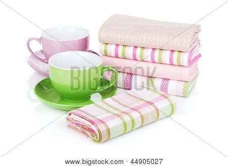 Kitchen towels and coffee cups. Isolated on white background