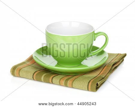 Coffee cup over kitchen towel. Isolated on white background