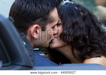 Happy Newlyweds Kissing In Cabrio
