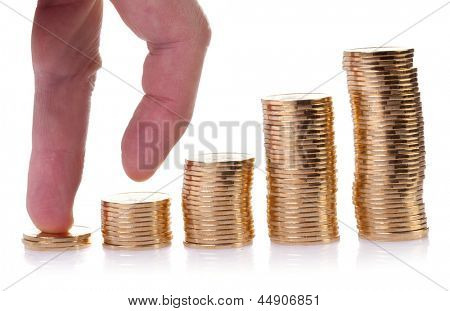 Climbing hand on gold coin staircase isolated on white background.