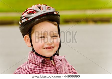 Young boy wearing safety helmet for bike riding