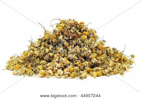 a pile of dried chamomile flowers on a white background