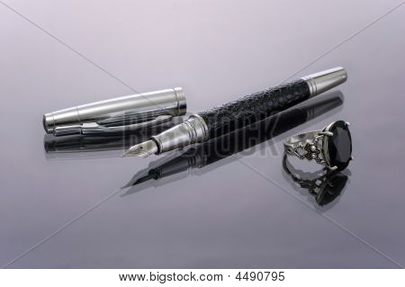 Pen With The Taken Off Tip And Silver Ring