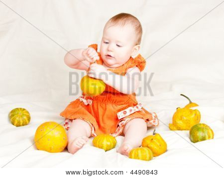 Infant With Pumpkins
