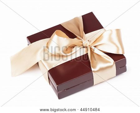 Box with candies and golden tape