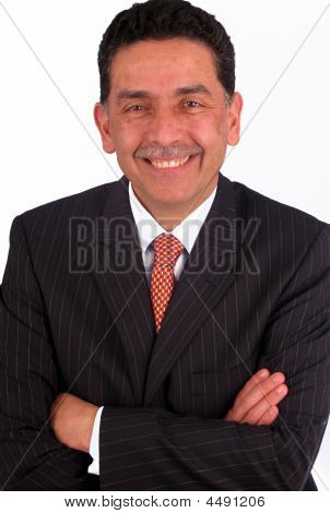 Man In A Suit With His Arms Crossed