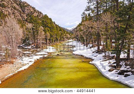 Mountain River In Spring Snow
