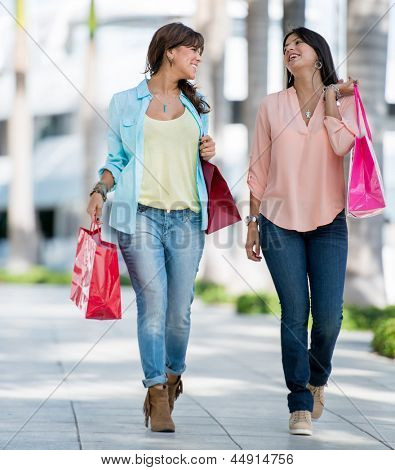 Beautiful women on a shopping spree carrying bags