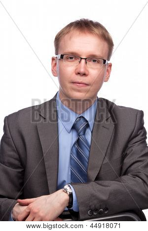 Young handsome man in grey suit and glasses isolated on white background